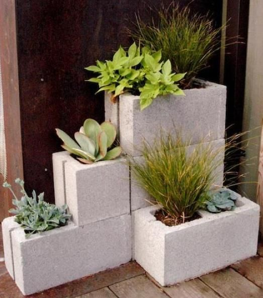 Basalite concrete blocks - as planters, they function as sculpture, especially when stacked randomly (if youre using them on a wood surface, protect the wood from contact with wet soil by setting the basalite block on top of a sheet of heavy plastic cut to the dimensions of the block base).