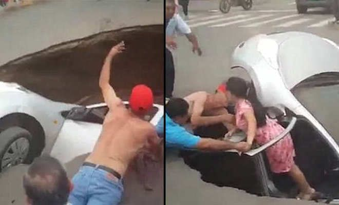 Family Of Three Rescued By Passers-By As Car Swallowed By Massive Sinkhole