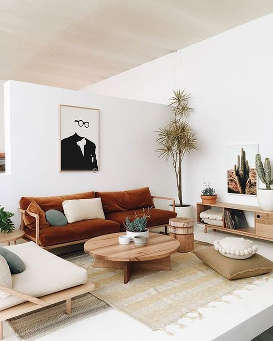 A Andi Living Room With Whites And Light Colored Wooden Furniture Cognac Textiles Sades Of Green For Cool Look