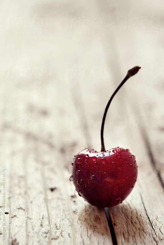 Tart #cherry on a #rustic wooden table. Simple and beautiful!