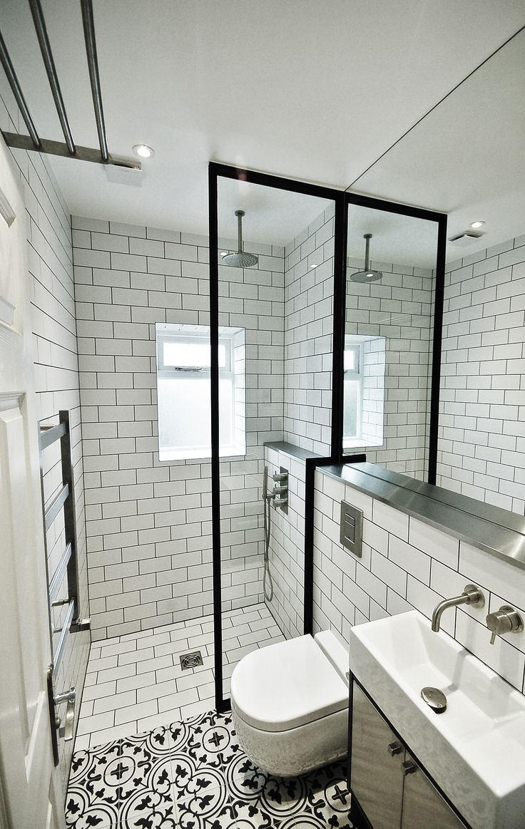The aim for this bathroom was to create a space that looks and feels bigger and brighter. This was achieved with a simple black and white colour palette and bold fixtures and fittings, giving the space a unique appeal. Encaustic floor tiles from Fired Earth uses french inspired patterns giving a feminine touch and helps to zone the two areas whilst a crittall style shower screen defines the shower enclosure. Stainless steel accents enhance the look adding another dimension to the space: