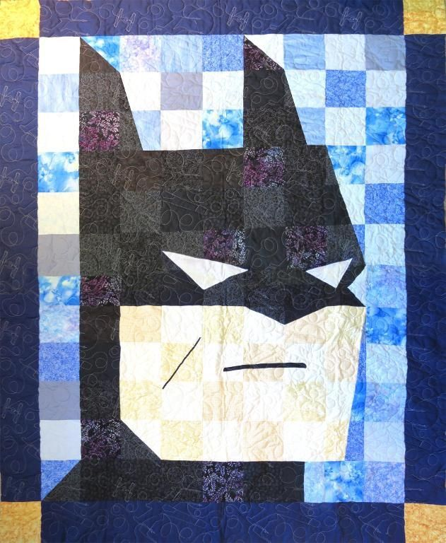 Batman Quilt pattern on Craftsy.com for 2.99 It don't think I need a pattern...looks simple