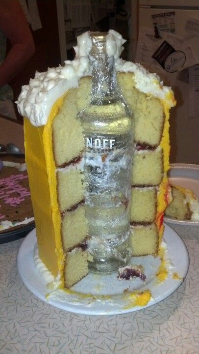 Great idea!! I think they probably wrapped the bottle in cling film to avoid any dirt on the bottle contaminating the cake. If I did this, I would probably use a bottle that had the name etc printed directly onto the bottle, rather than a label. Then we could make sure the bottle is 100% clean.