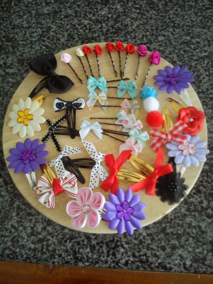 Hair accessories made from ribbon flowers, gems, ribbon bows, felt pom poms and various hair clips