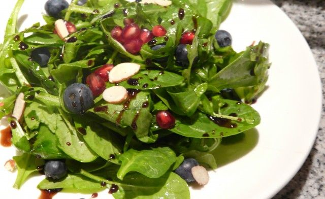 Arugula Salad with Pomegranate Seeds and Blueberries - Against All Grain