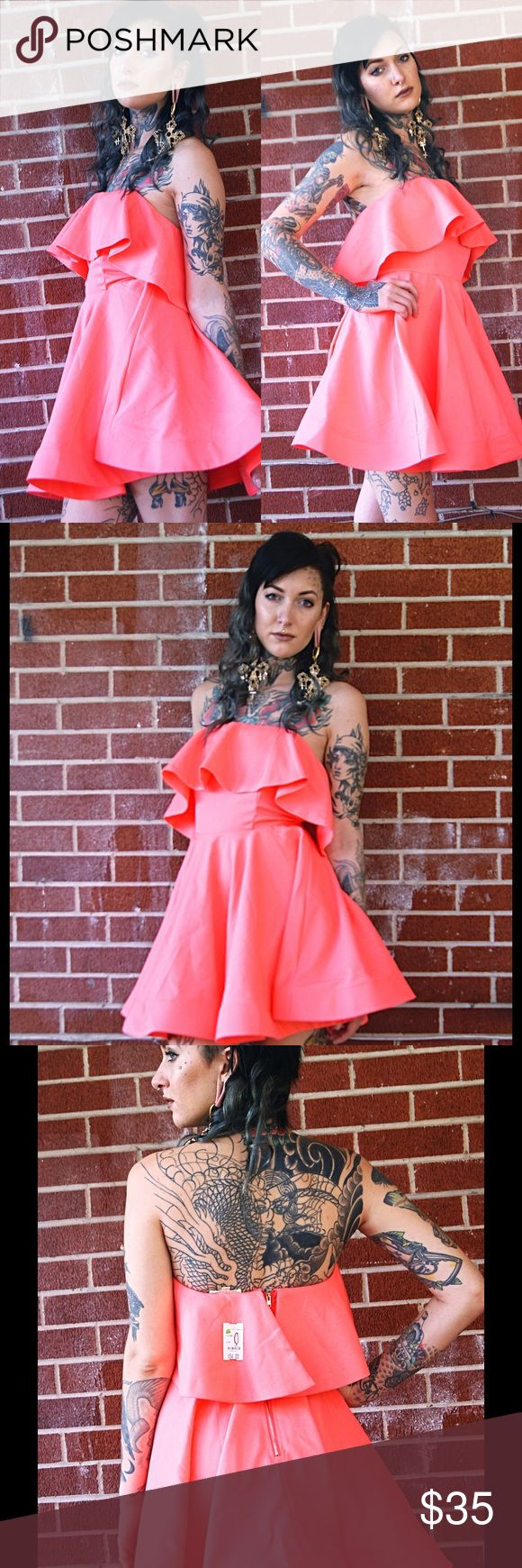 Luxxel salmon orange Dress strapless empire waist Size: 0 small Band: Luxxel NWT has a non slip lining and is zipper back. Super cute full skirt. Strapless fits great. Didn't have an occasion to wear it though luxxel Dresses Strapless