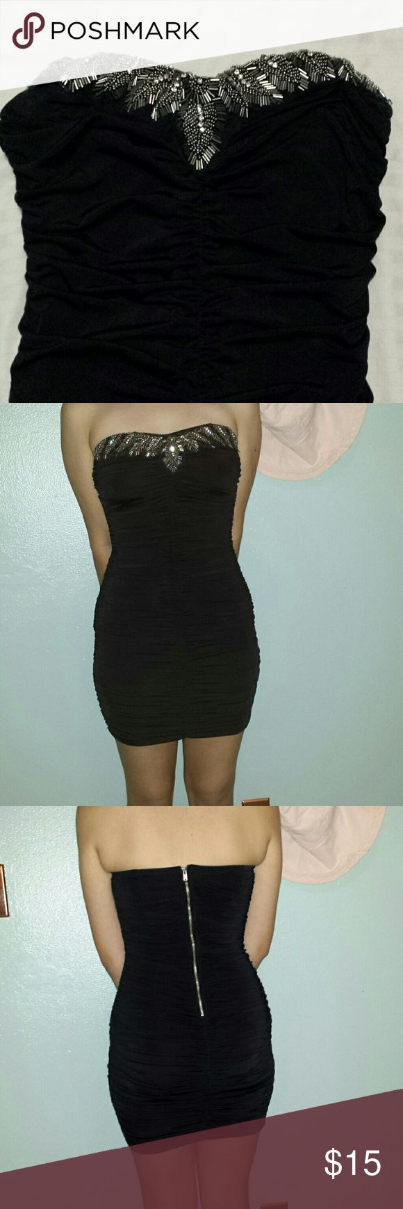 Black evening /party dress Fitted strapless  ruched dress. Sparkly detail at the chest. Fabulous number for ringing in the new year. Forever 21 Dresses Mini