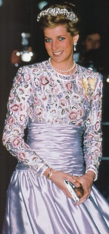 Lilac Clerici crepe dress with English stitchwork embroidery in chenilles and silks.  Commissioned for a state visit to the United Arab Emirates in March, 1989.  Designer, Catherine Walker wished to capture an English country garden feel.