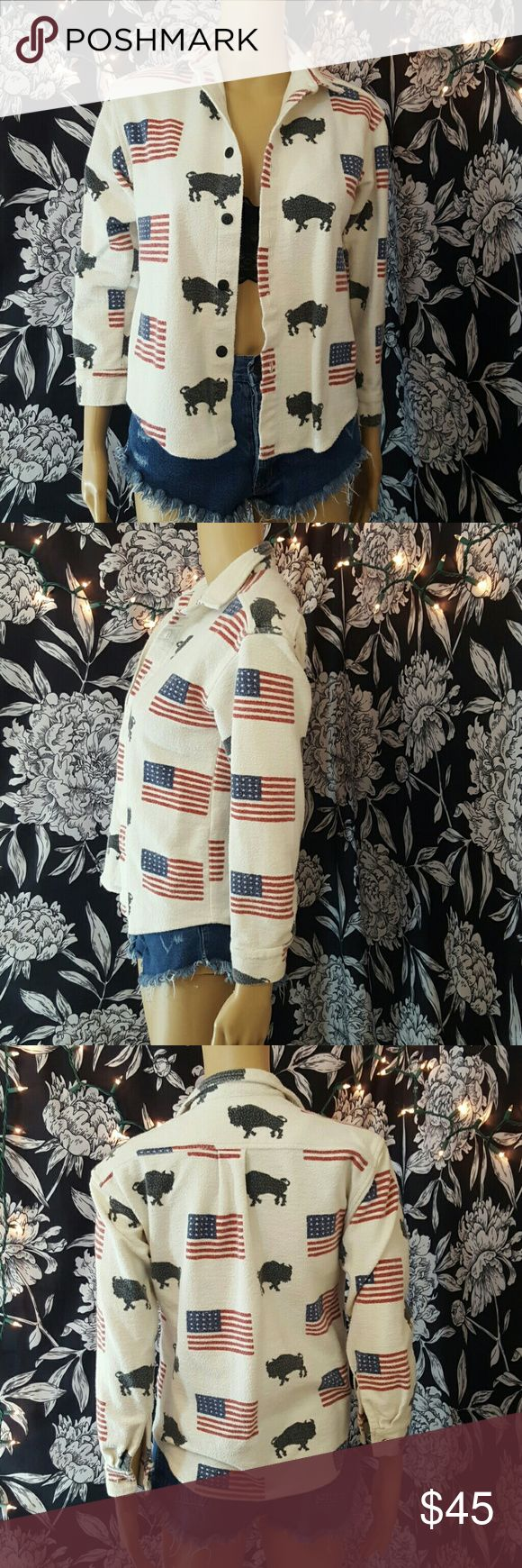 """Vintage americana button down Cream colored button down with American flag & bison print.    Brand- true grit Size- s  Approximate measurements laying flat  17.5"""" underarm to underarm  23"""" top of shoulder to bottom hem  19.5"""" sleeve length Vintage Tops Button Down Shirts"""