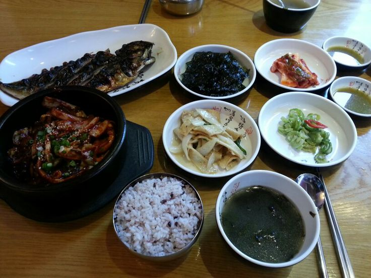 Hot spicy squid stir fry and grilled mackerel. Steamed rice and all side dishes followed.