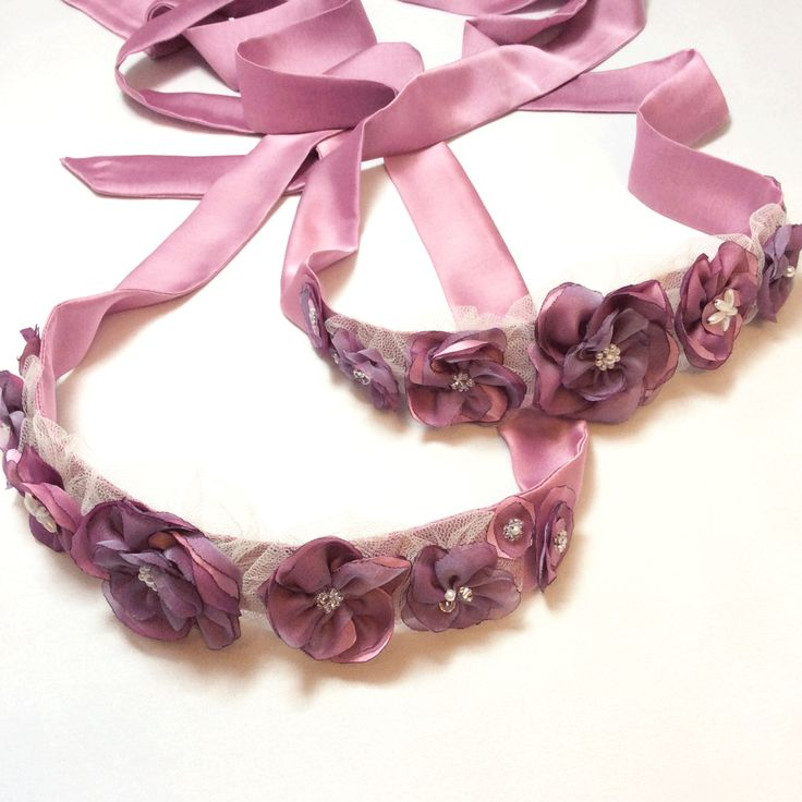 A pair of similar berry-coloured sash for cute twin flower girls. Made to match the wedding colour themes and the simple ivory dresses. Flower Girl Sashes. Bridesmaids Sashes. Wedding. Matching Sashes.