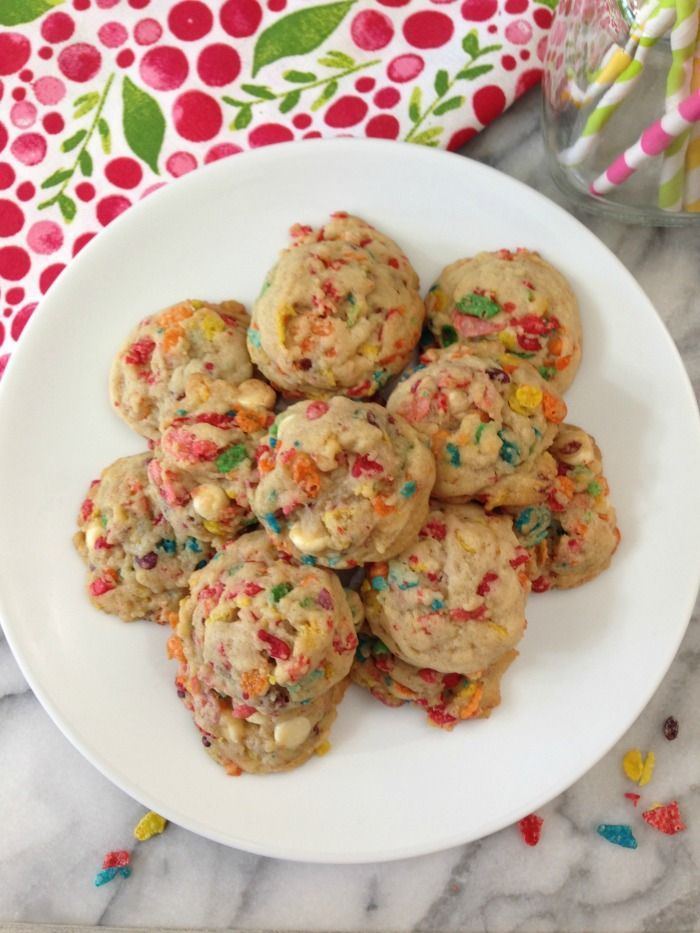 Fruity Pebbles Cookies - A light, buttery, confetti cookie made with Fruity Pebbles Cereal. They are only 69 calories a cookie.
