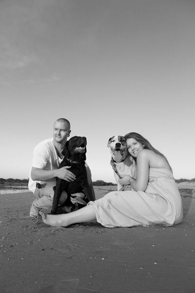 Portrait of a couple on the beach with their dogs