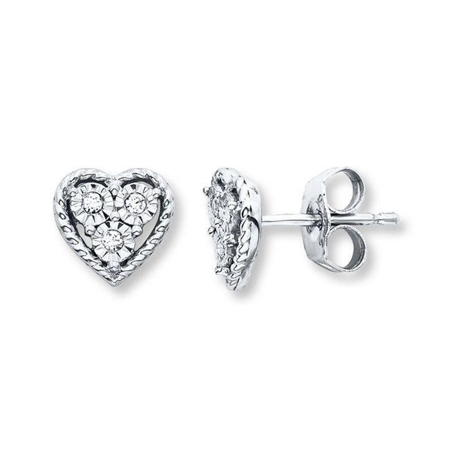 Each of these sweet earrings for her features a trio of diamonds sparkling from within a heart-shaped frame of twisted sterling silver. Totaling 1/20 carat in diamond weight, the earrings secure with friction backs. Diamond Total Carat Weight may range from .04 - .06 carats.