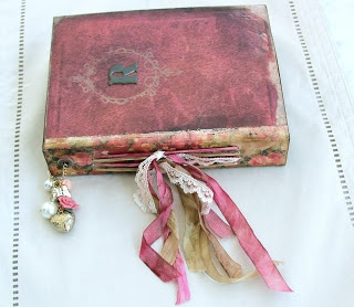 Journal made with papers from Nectars creations....spine is IOD paper.