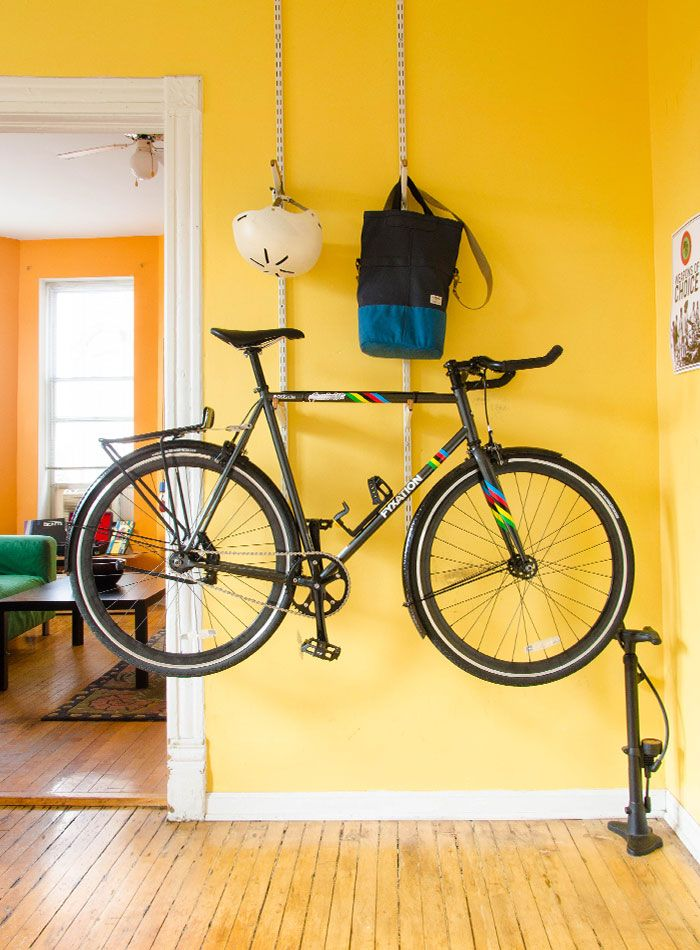 easy bike hanging station  -  In Chicago, a Vibrant Century-Old Apartment | Design*Sponge