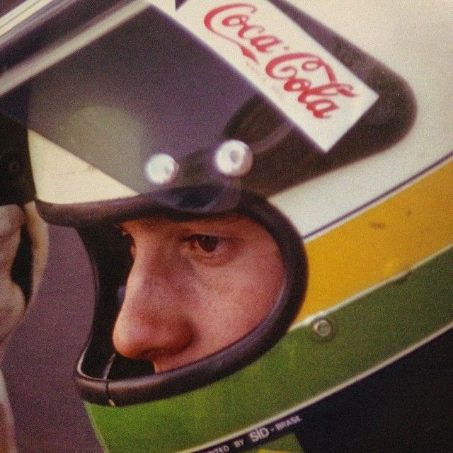 """""""Ayrton Senna concentrated and using the helmet painted by legendary Sid Mosca"""