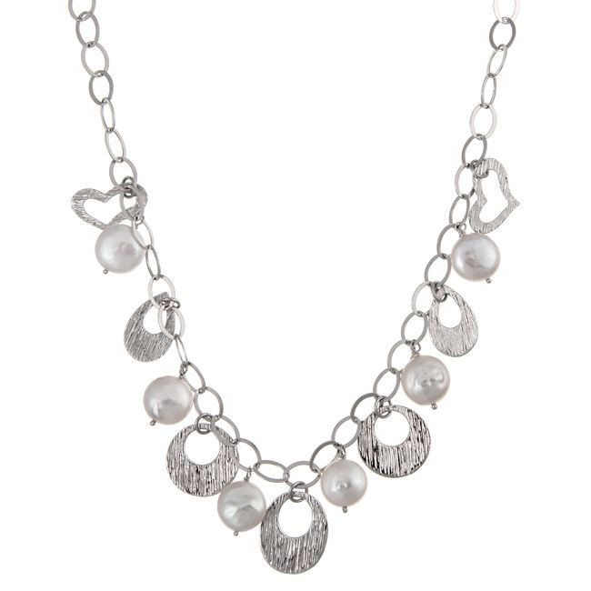 Serrated circle, oval, heart and teardrop medallions decorate this pretty necklaceThe jewelry is crafted of bright sterling silverCultured freshwater coin pearls alternate with medallions along the necklace
