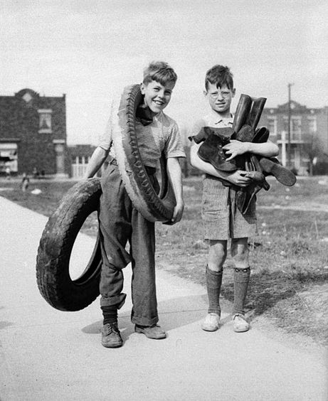 Kids were good at scavenging. Encouraged by their parents and teachers, plus incentives such as free passes to movies, kids collected tons of metal, paper, rubber, and grease. These materials were in short supply and were recycled into weapons and war machines. Some kids even donated their own toys for metal salvage drives. These two boys in Montreal were photographed in April 1942, collecting collect rubber tires and boots to be recycled as part of Canada's war effort.