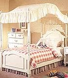 I had a holly hobby canopy bed like this when i was a little girl , ahh the memories!