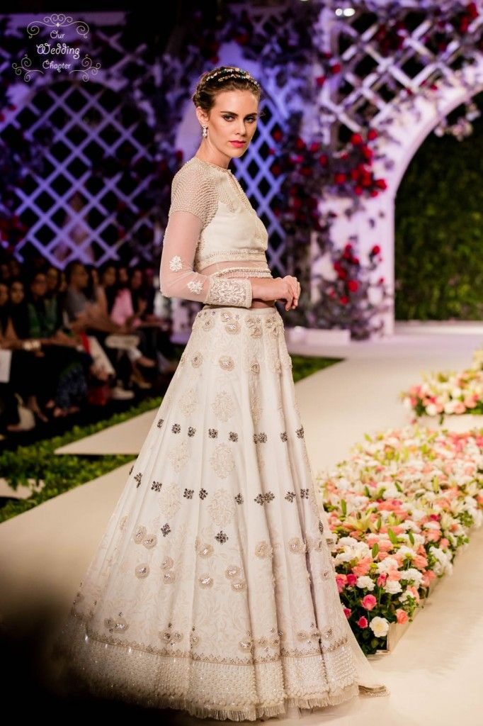 ivory lehenga with pearl bead work and threadwork embroideryis set to make the bride rock her wedding  #Trending, #TrendingBridalWear, #BridalWearInspirations, #LehengaInspirations, #TrendingLehengas, #BridalLehengas, #BridalWear, #RedLehengas, #PastelLehengas, #Sabyasachi, , Bridal Lehengas