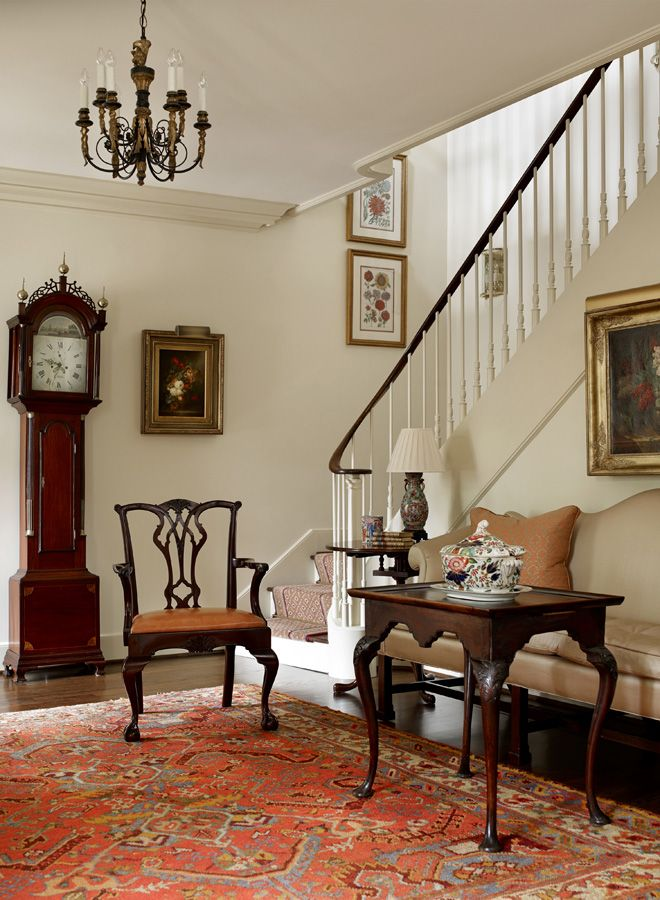 Love the warm welcome in this foyer. The classic furniture and warm red of the rug pull you right in.