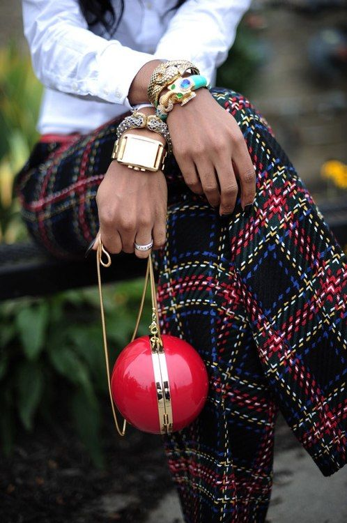 hummm.  . .. not sure which is more attractive - the plaid, the ball purse or the jewelry . . . . .
