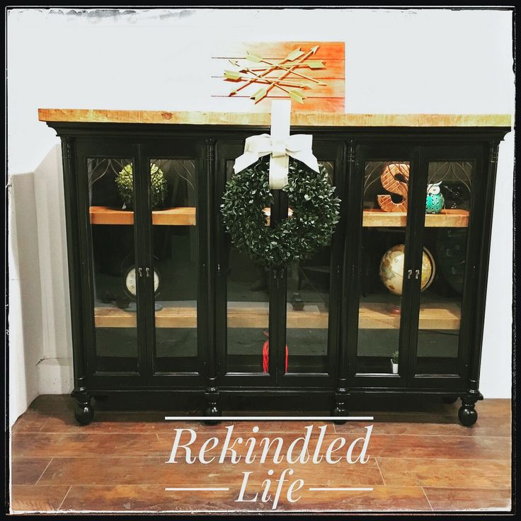 A repurposed china cabinet top that has the top and glass shelves replaced with rough cut pine