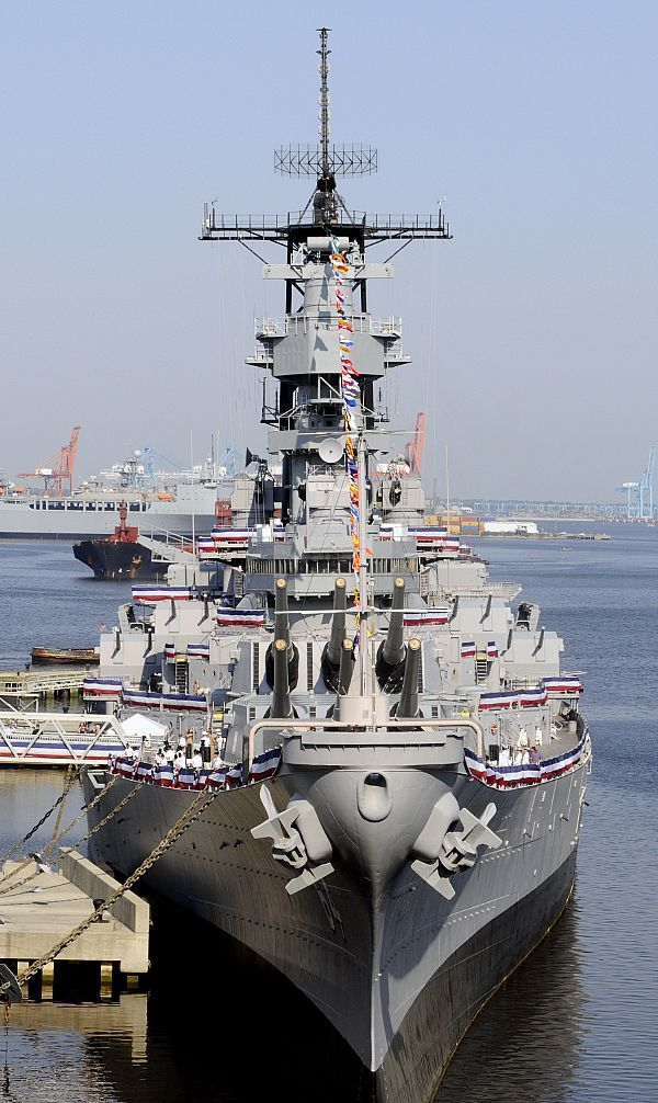The decommissioned Iowa-class battleship USS Wisconsin (BB-64) is berthed at NAUTICUS in downtown Norfolk during a ceremony officially transferring Wisconsin from the U.S. Navy to the city of Norfolk.
