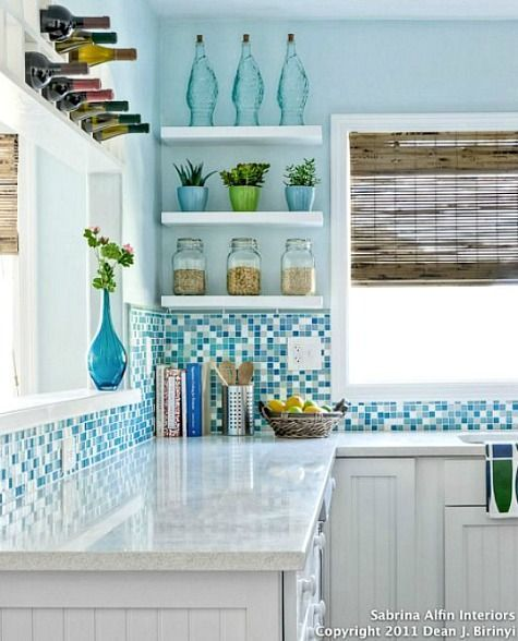 Coastal Kitchens with Ocean Blue Backsplash Tiles: http://www.completely-coastal.com/2015/11/kitchen-backsplash-ideas-beach-murals-nautical-ocean-blue-tiles.html