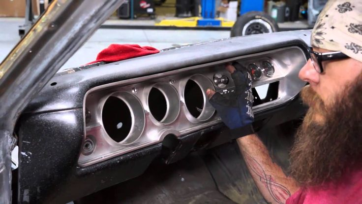Paul Naber, American Modern's claim adjuster, a.k.a. car guys, is working on straightening out the dash on the 65 Chevy Malibu SS. Like The Build? Subscribe to our YouTube channel and follow along on Facebook: https://www.facebook.com/AmericanModernCollectorCar @American Modern Insurance Group
