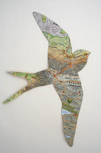Jen & Carolyn -- Silhouettes can be made by other materials, like this map! This idea is interesting with the bird relating to travel and the map.