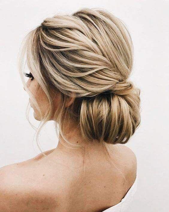 French twist pulled back into an elegant chignon with loose pieces left out.  #a…
