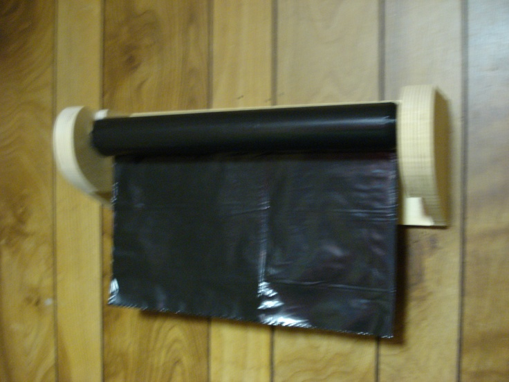 This is a garbage roll holder. Much like a paper towel holder, only bigger. Makes life so much easier!