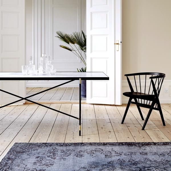 This large, marble topped dining table exudes luxurious Nordic appeal. Handmade by Danish design studio HANDVÄRK, the design is a modern take on a tile top table, with ten large pieces of honed or polished marble mounted in a slender black frame.