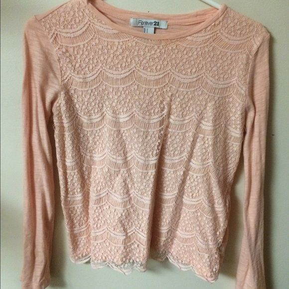 Forever 21 long sleeve tee shirt Light pink casual long sleeve tee shirt with lace in the front. In great condition! Prices negotiable. Forever 21 Tops Tees - Long Sleeve