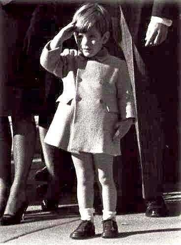 John F. Kennedy Jr as he salutes the flag during his father's funeral.