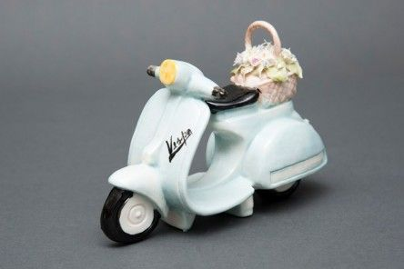 Gracious and faithful reproduction of the Italian Lambretta from La Dolce Vita in Capodimonte porcelain finely decorated with floral basket and painted of blue. Available in various colors.  www.apoggi.com     Dimensions cm. 10x15