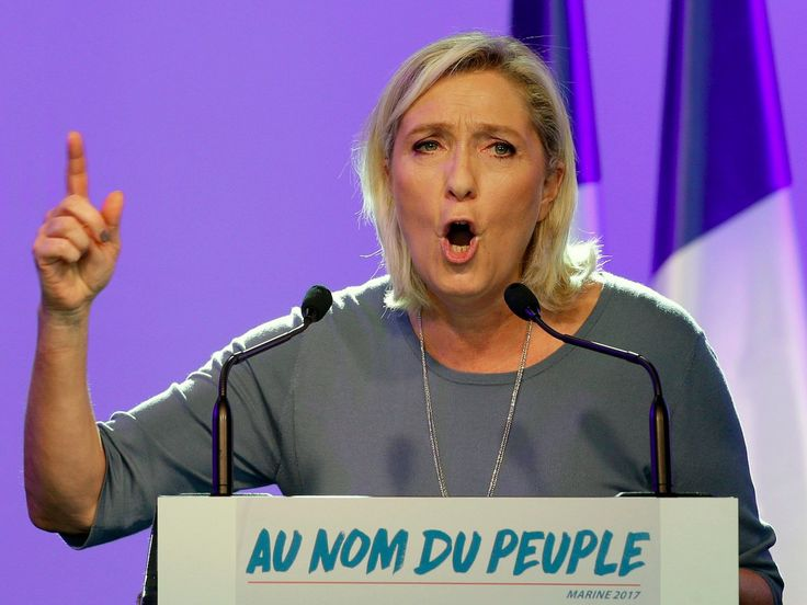 France's far-right National Front president Marine Le Pen, delivers her speech during the summer meeting, 'Les Estivales de Marine Le Pen', in Frejus, southern France, Sunday, Sep. 18, 2016. ()