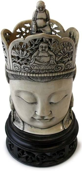 Antique Chinese Ivory Carving  Quan Yin  Amida Buddha on Crown  Origin: China. Circa: early 1900s'  H 7 in.(17.5cm), W 3.5 in.(9cm), D 2.5 in.(6.4cm)  Total Height including custom wood base 8.75 inches    Quan-Yin is the goddess of compassion. Abundantly popular throughout East Asia she is the progenitor of good fortune, good luck and illumination.