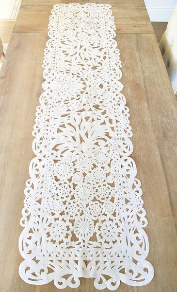 Mexican fabric table runner, in lovely Papel Picado design. Flower lace detail, All white. Beautiful as wedding decor, bridal showers, baby showers. You will surely wow your guests with this work of a