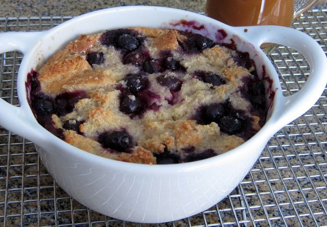 This blueberry bread pudding serves two to three people. Serve this simple, tasty bread pudding with vanilla sauce or a lemon sauce for a delicious everyday dessert.