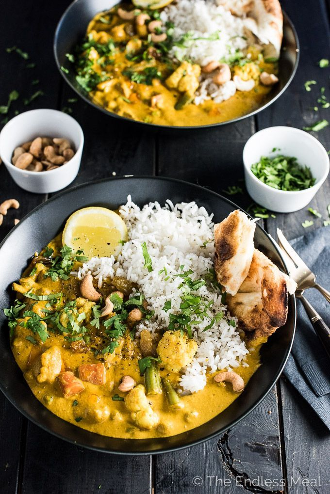 Creamy Coconut Vegetarian Korma | This easy to make and healthy Meatless Monday dinner recipe will be a hit at your table. It's a naturally paleo and gluten free Indian curry recipe that can easily be made vegan. | theendlessmeal.com #indian #makeahead