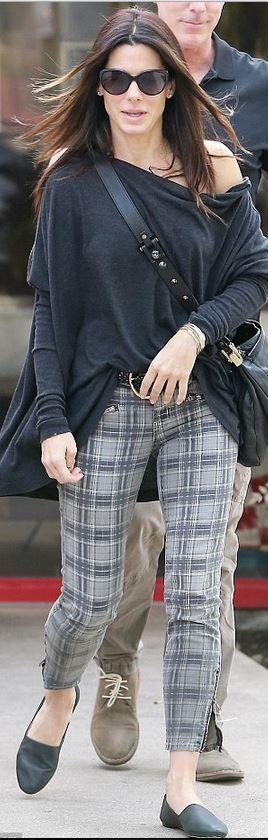 Who made  Sandra Bullock's gray plaid pants and black handbag?