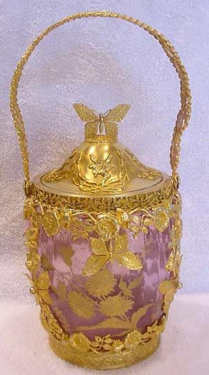 French Cranberry Glass Biscuit Jar with Gilded Bronze Dore Art Nouveau Butterflies, Dragonflies, and Flowers Circa 1880 - 1900