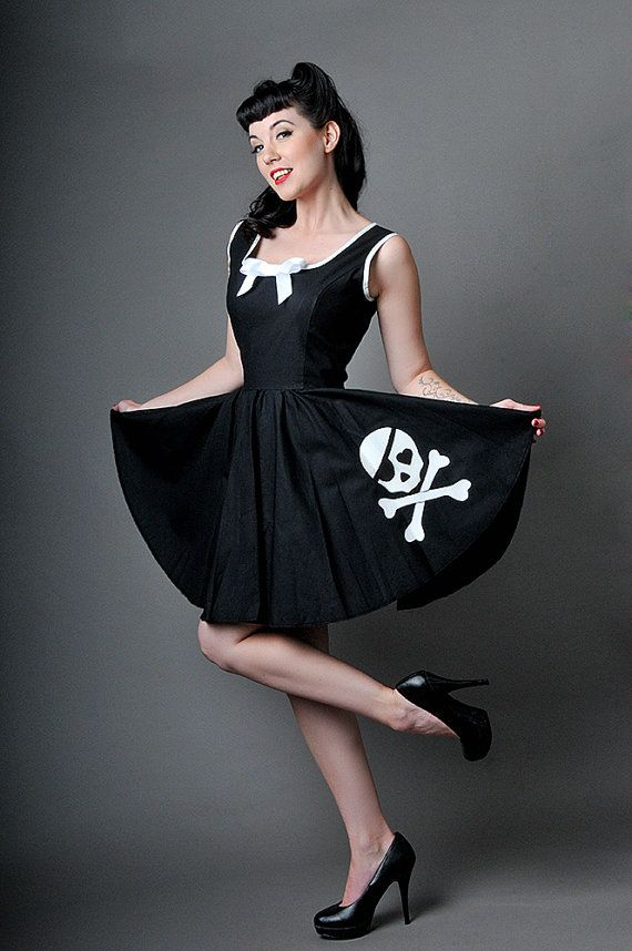 Skull are for life, not just Halloween! This gorgeous Gothic dress is made from black 100% cotton poplin with contrasting white binding and bow. The