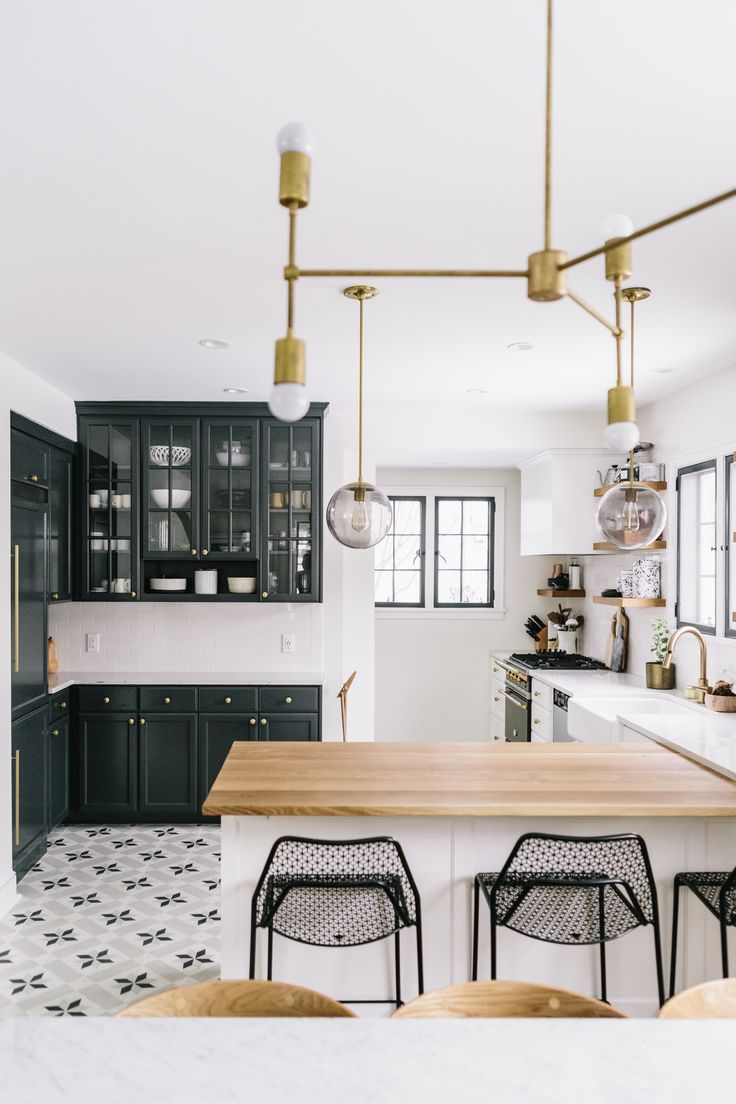 Black And White Kitchen With Brass Hardware And Cement Tile
