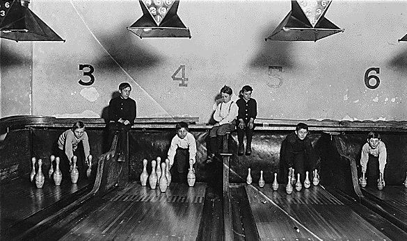 Manual pin setters before the mechanical pin setters were invented.