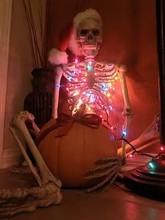 Neat idea to put a string of Christmas or even orange Halloween lights inside a skeleton display on the porch.