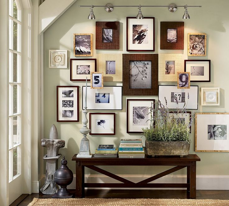 absolutely love mismatched frame walls :)